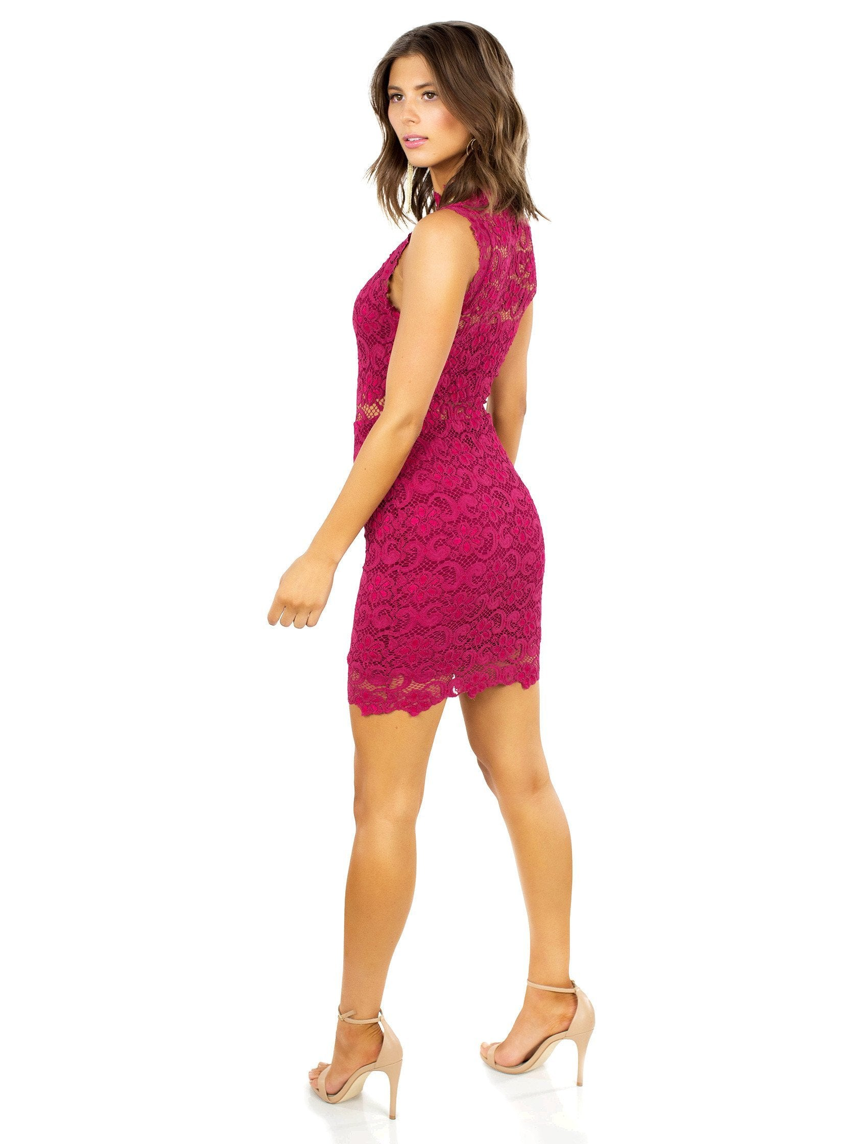 Woman wearing a dress rental from Nightcap Clothing called Dixie Lace Cutout Mini Dress