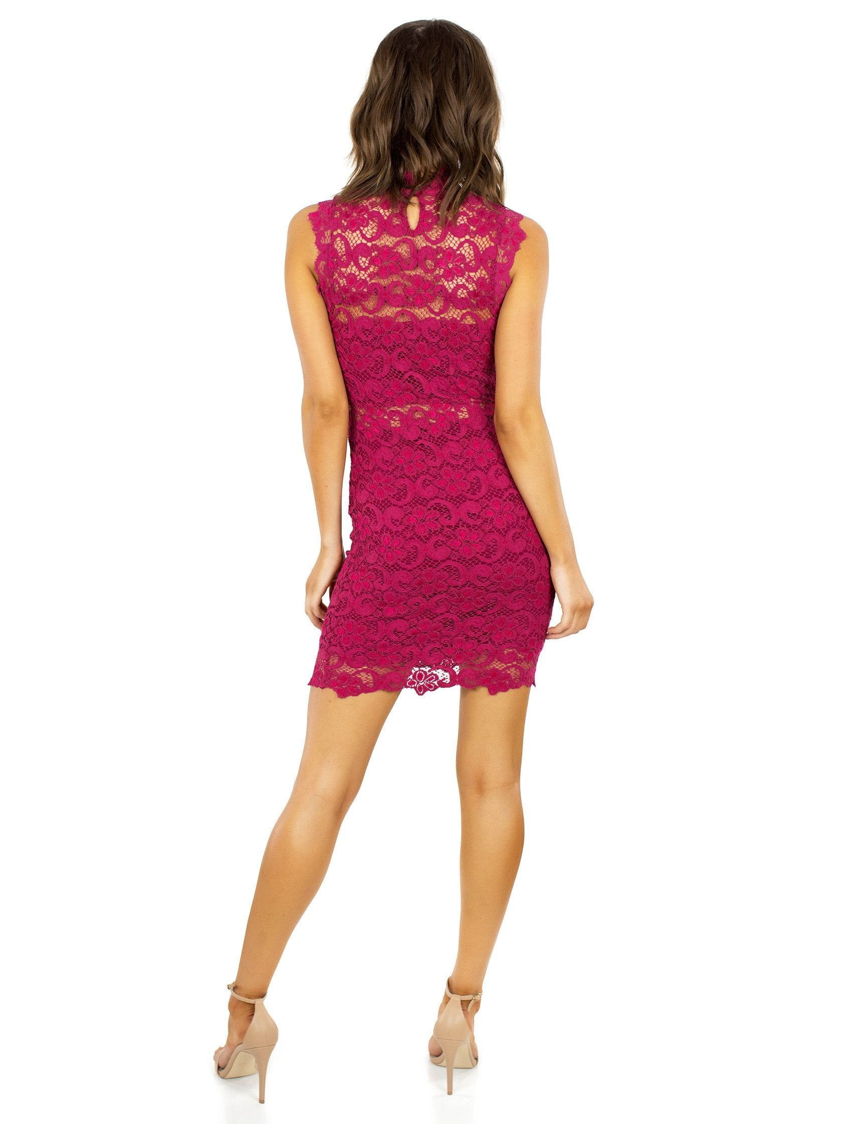 Women wearing a dress rental from Nightcap Clothing called Dixie Lace Cutout Mini Dress