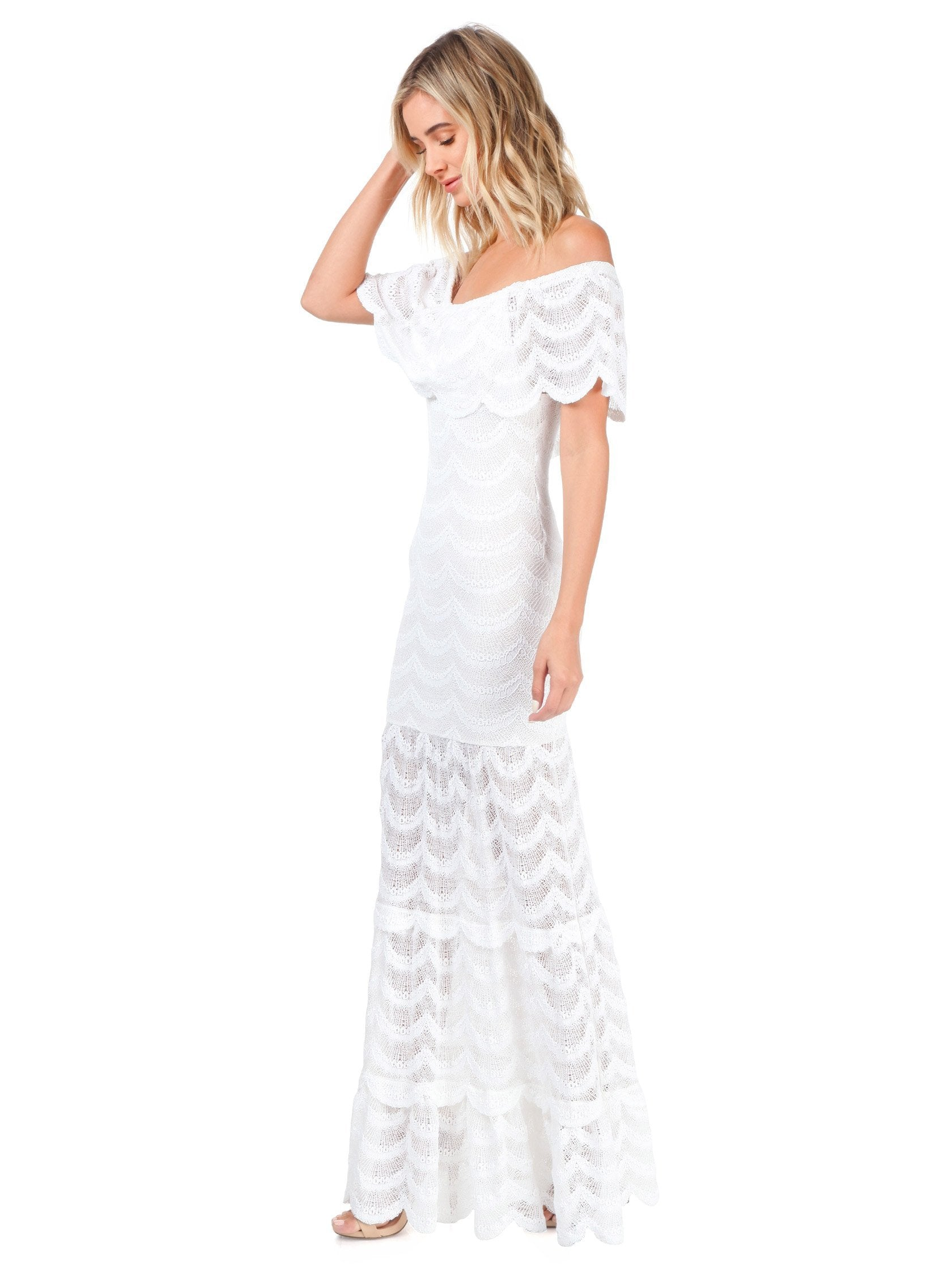 Women outfit in a dress rental from Nightcap Clothing called Fiesta Fan Lace Positano Maxi