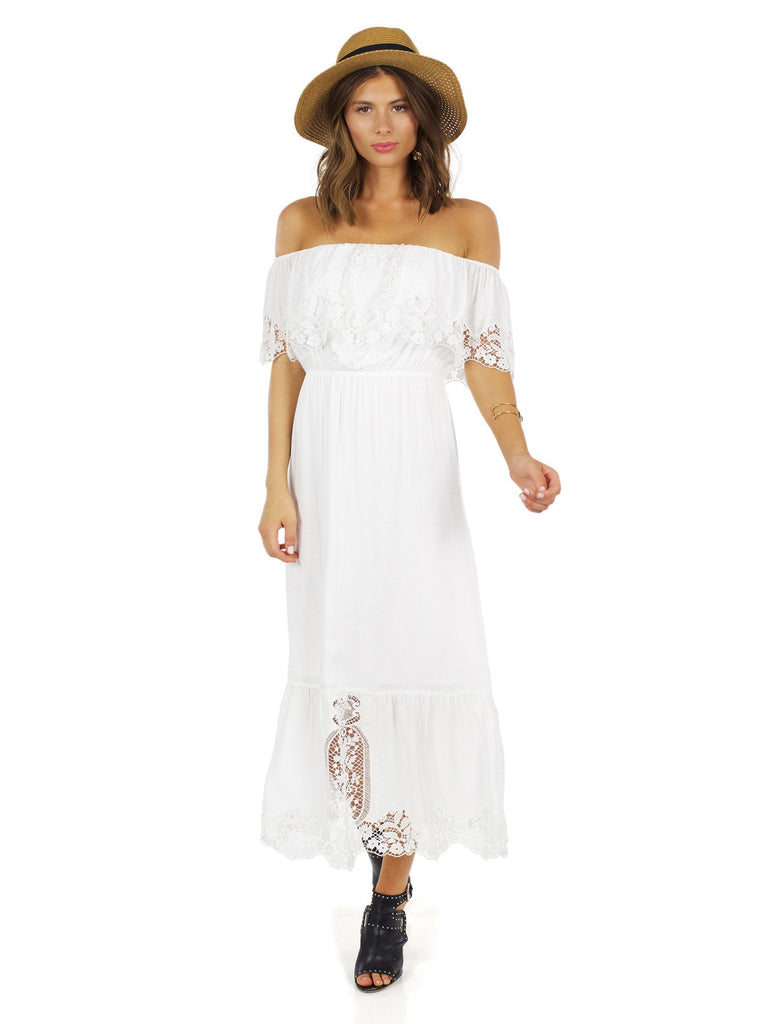 Girl wearing a dress rental from Nightcap Clothing called Mayan Lace Gown