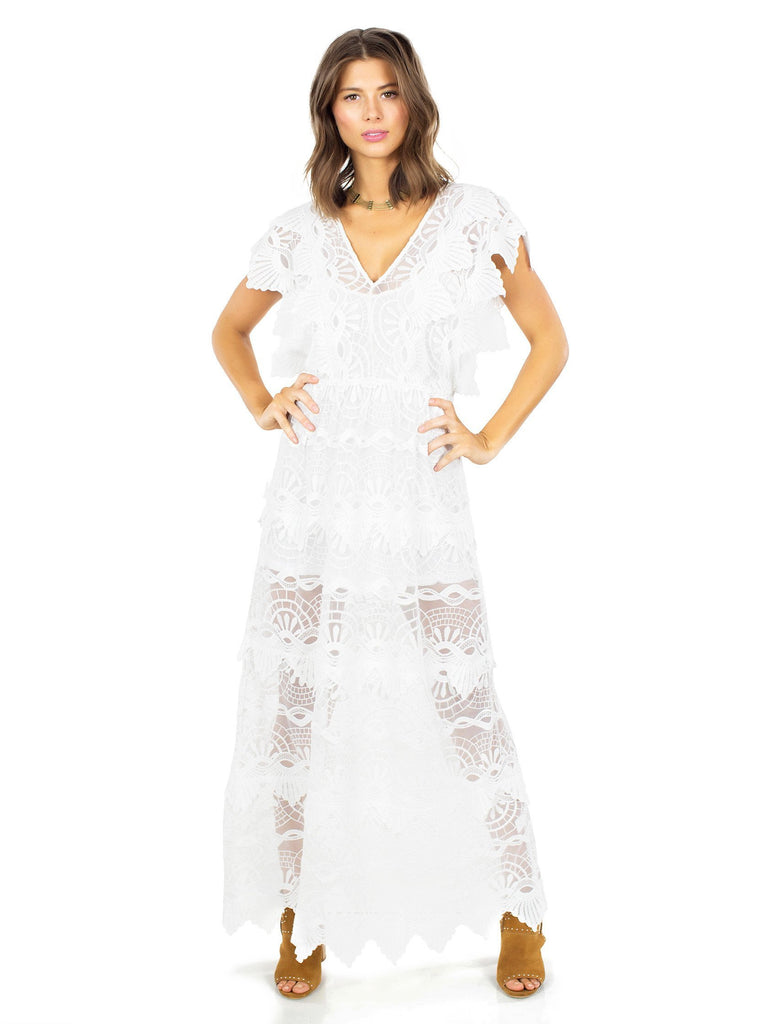 Women outfit in a dress rental from Nightcap Clothing called Mayan Lace Gown