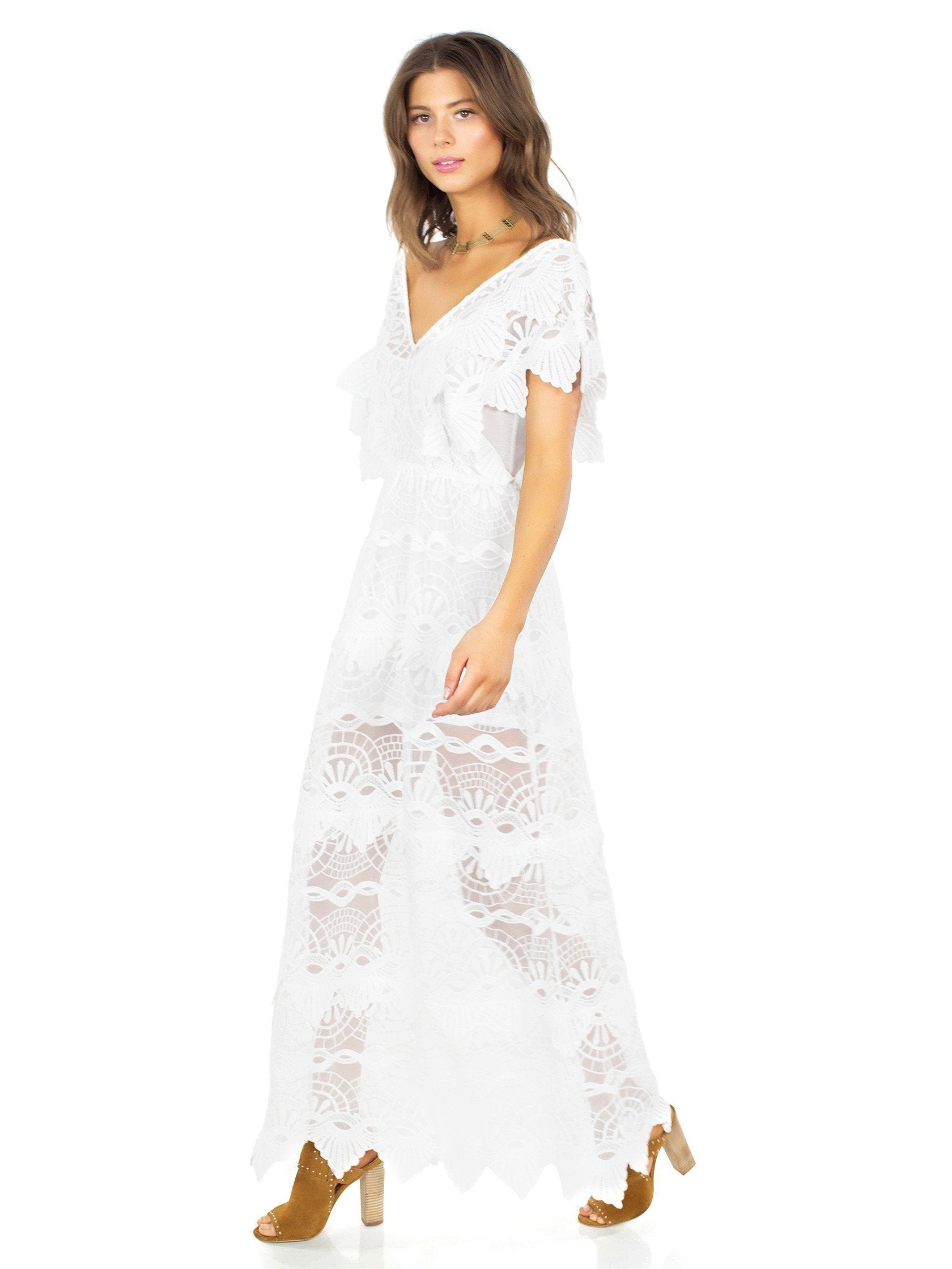 Woman wearing a dress rental from Nightcap Clothing called Mayan Lace Gown