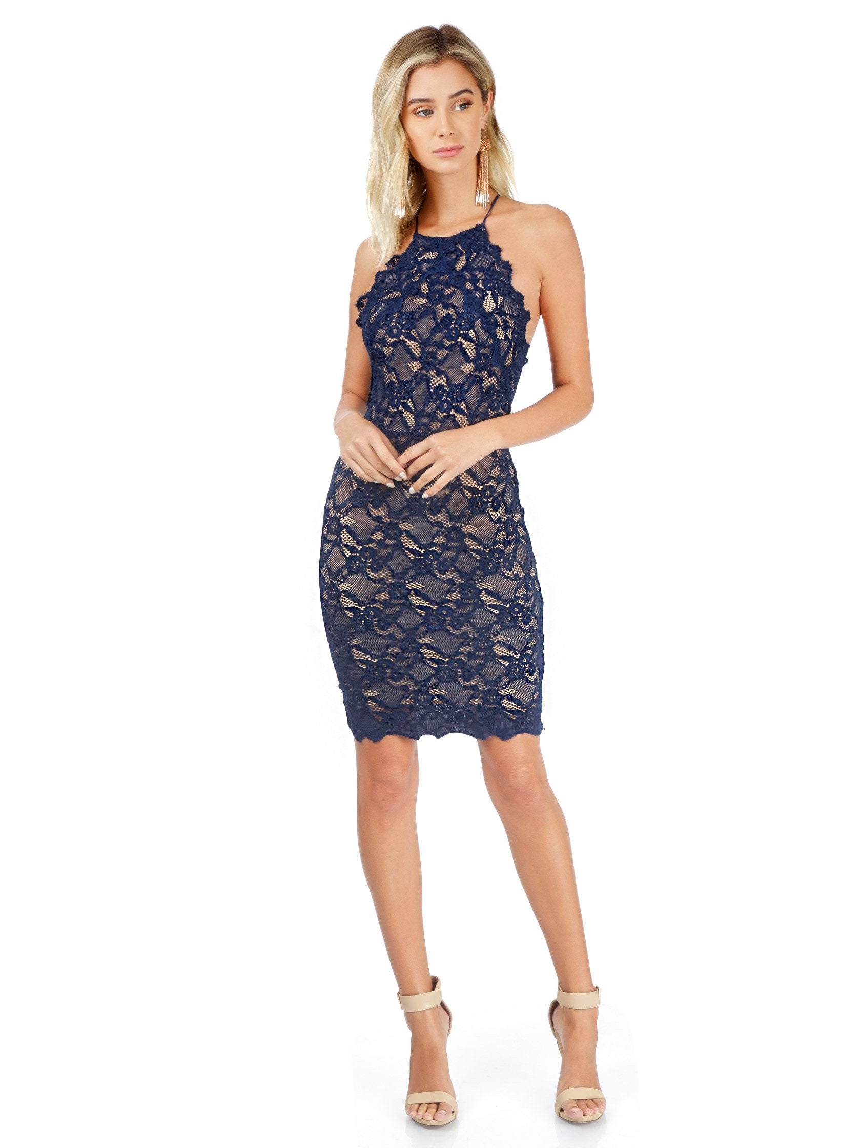 Women outfit in a dress rental from Nightcap Clothing called Navy Drive Me Home Mini Dress