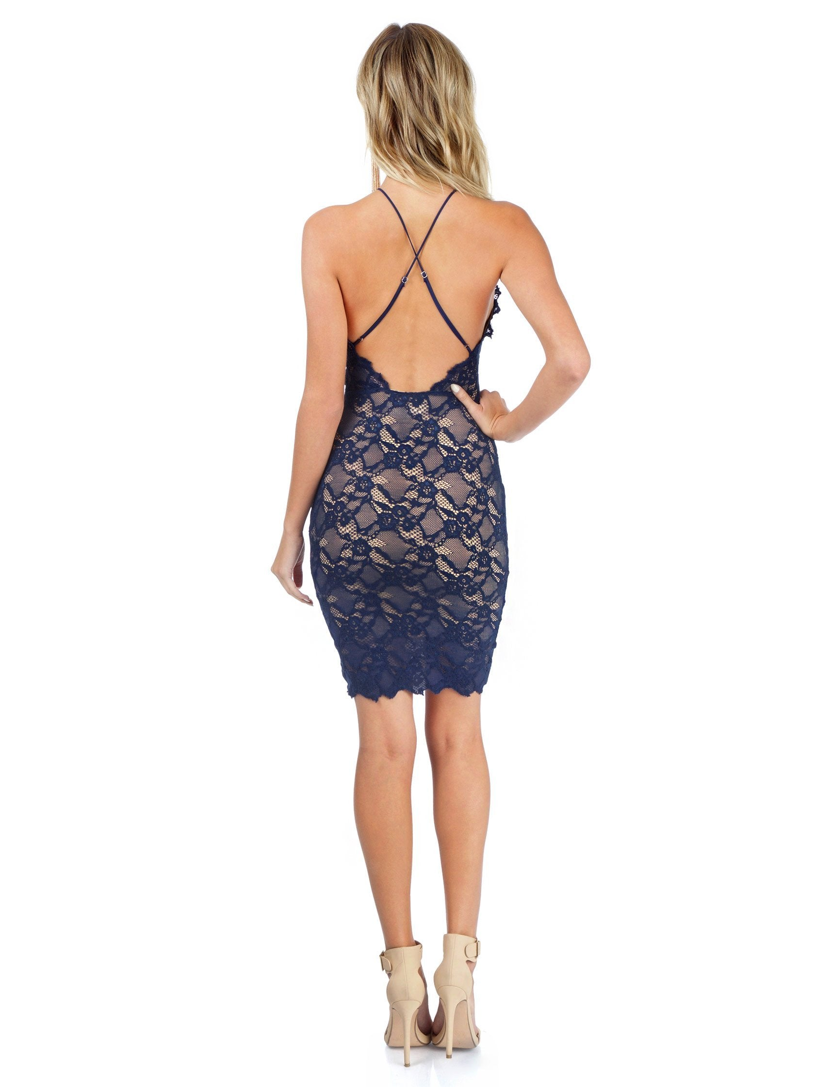 Women wearing a dress rental from Nightcap Clothing called Navy Drive Me Home Mini Dress