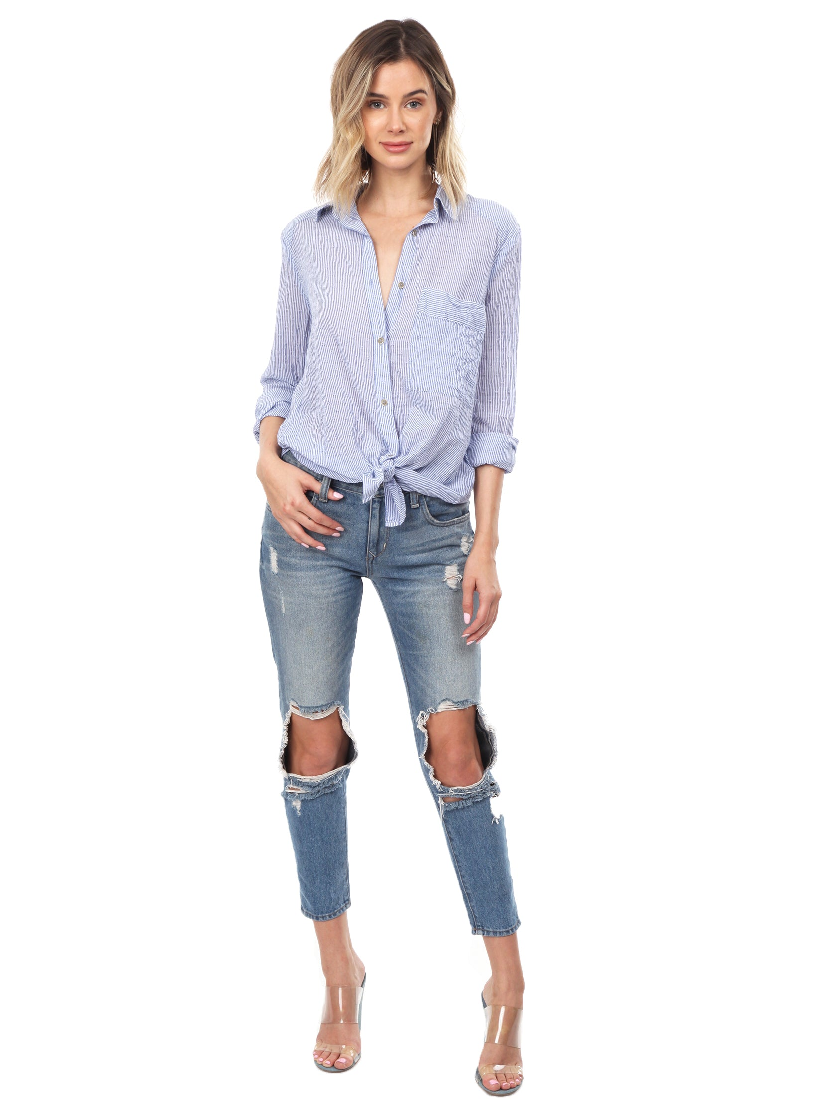 Woman wearing a top rental from Free People called No Limits Stripe Stretch Cotton Shirt