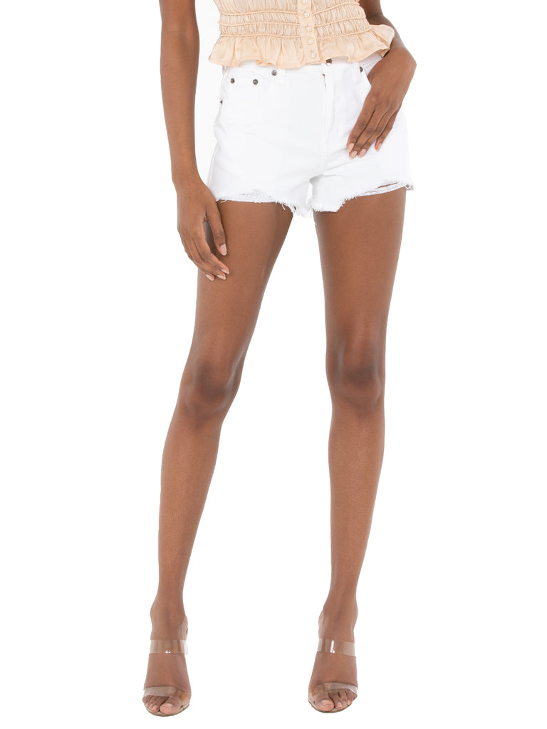 Woman wearing a shorts rental from PISTOLA called Tempest Dress