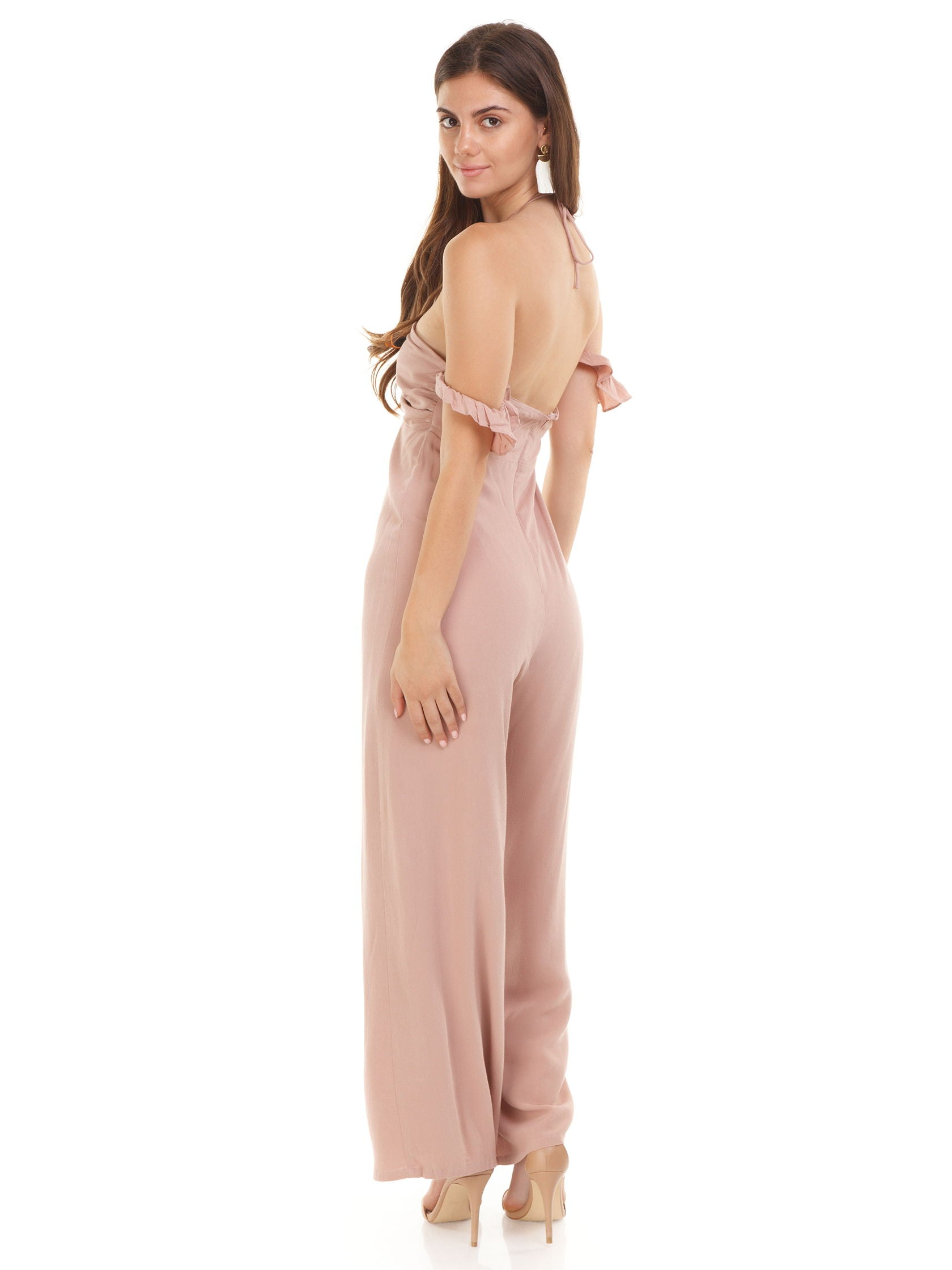 Women wearing a jumpsuit rental from Sadie & Sage called Off Shoulder Babydoll Jumpsuit