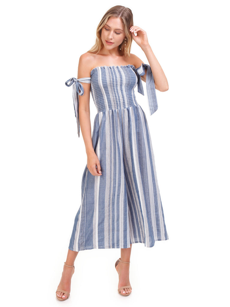 Women wearing a jumpsuit rental from SURF GYPSY called Off Shoulder Gaucho Jumpsuit