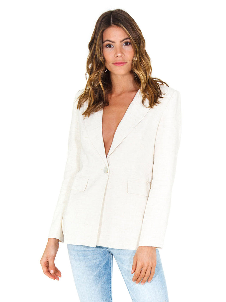 Woman wearing a blazer rental from Lost In Lunar called Sienna Trench