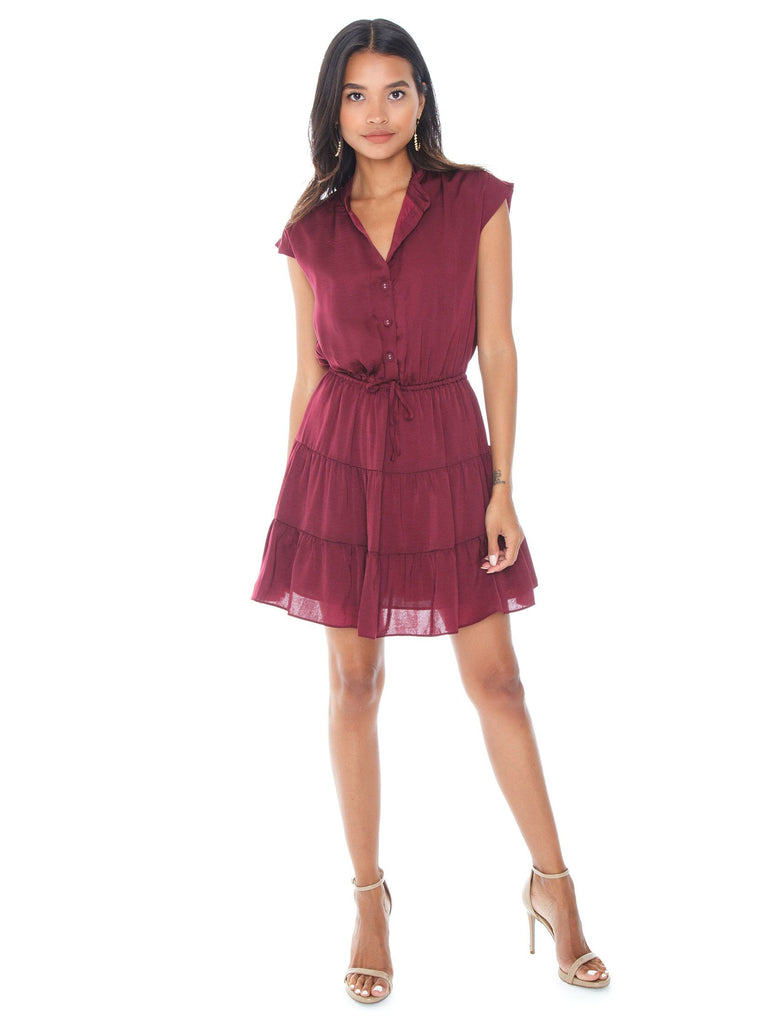 Woman wearing a dress rental from REBECCA MINKOFF called Tie Neck Smocked Waist Blouse