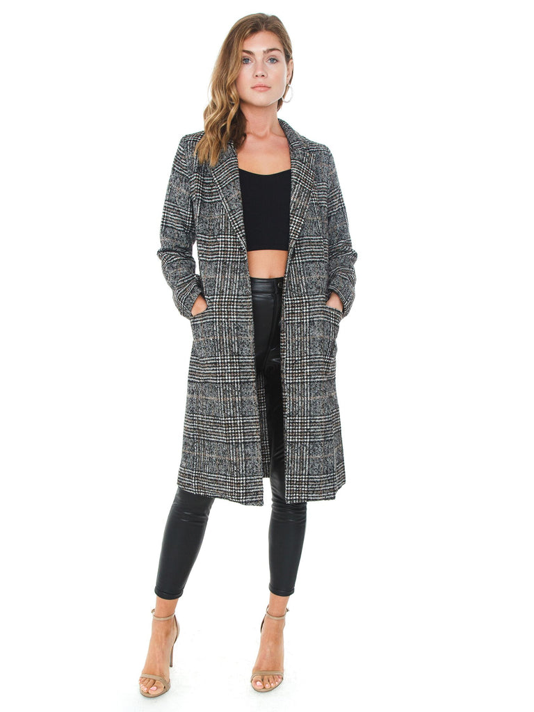 Woman wearing a jacket rental from SAGE THE LABEL called Still The One Wrap Coat