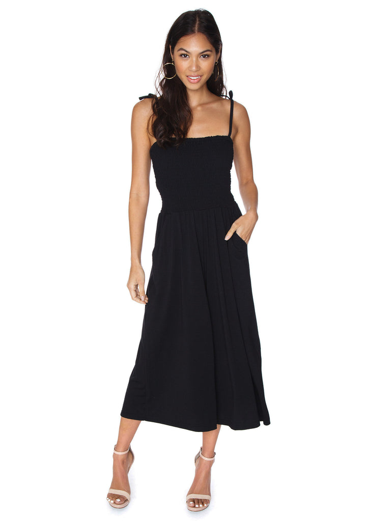 Girl wearing a jumpsuit rental from BB Dakota called Ruffle Cold Shoulder Dress