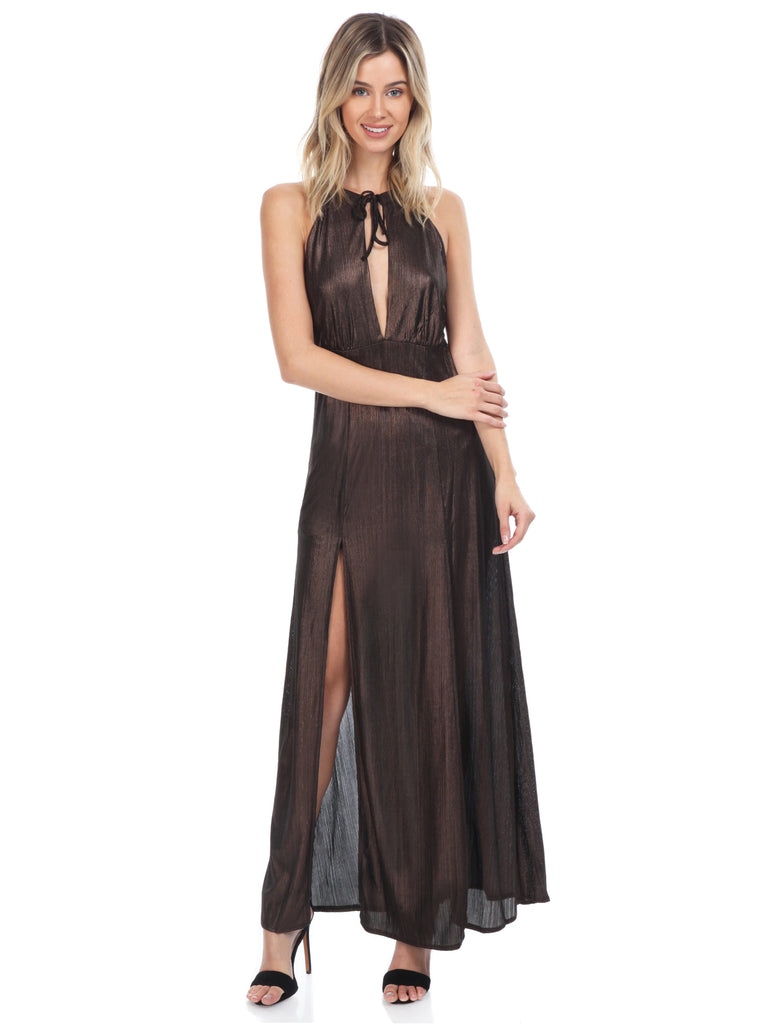 Girl wearing a dress rental from WYLDR called Abby Off Shoulder Tiered Maxi Dress