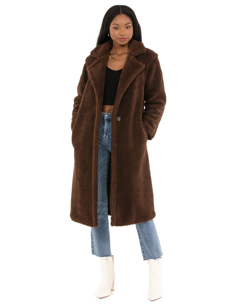 Woman wearing a coat rental from BB Dakota called Faux Leather Jogger