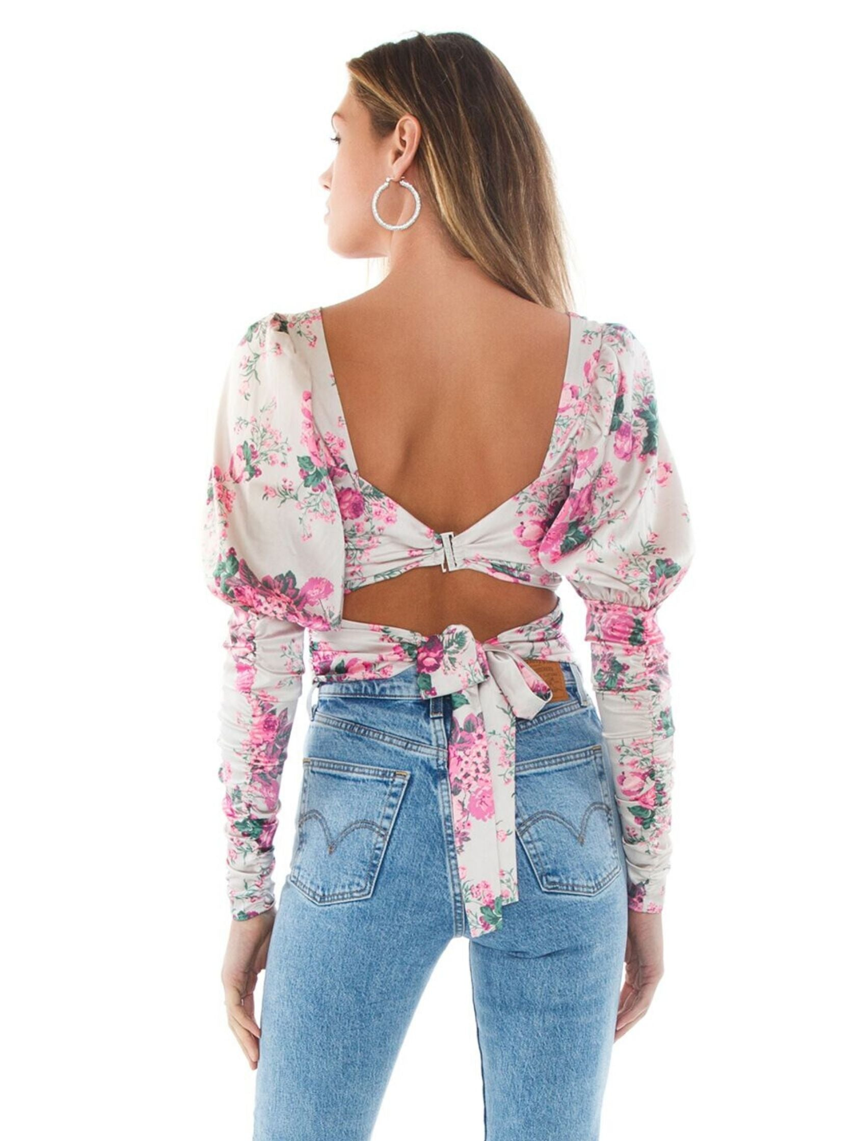 Women outfit in a top rental from For Love & Lemons called Palais Floral Crop Top