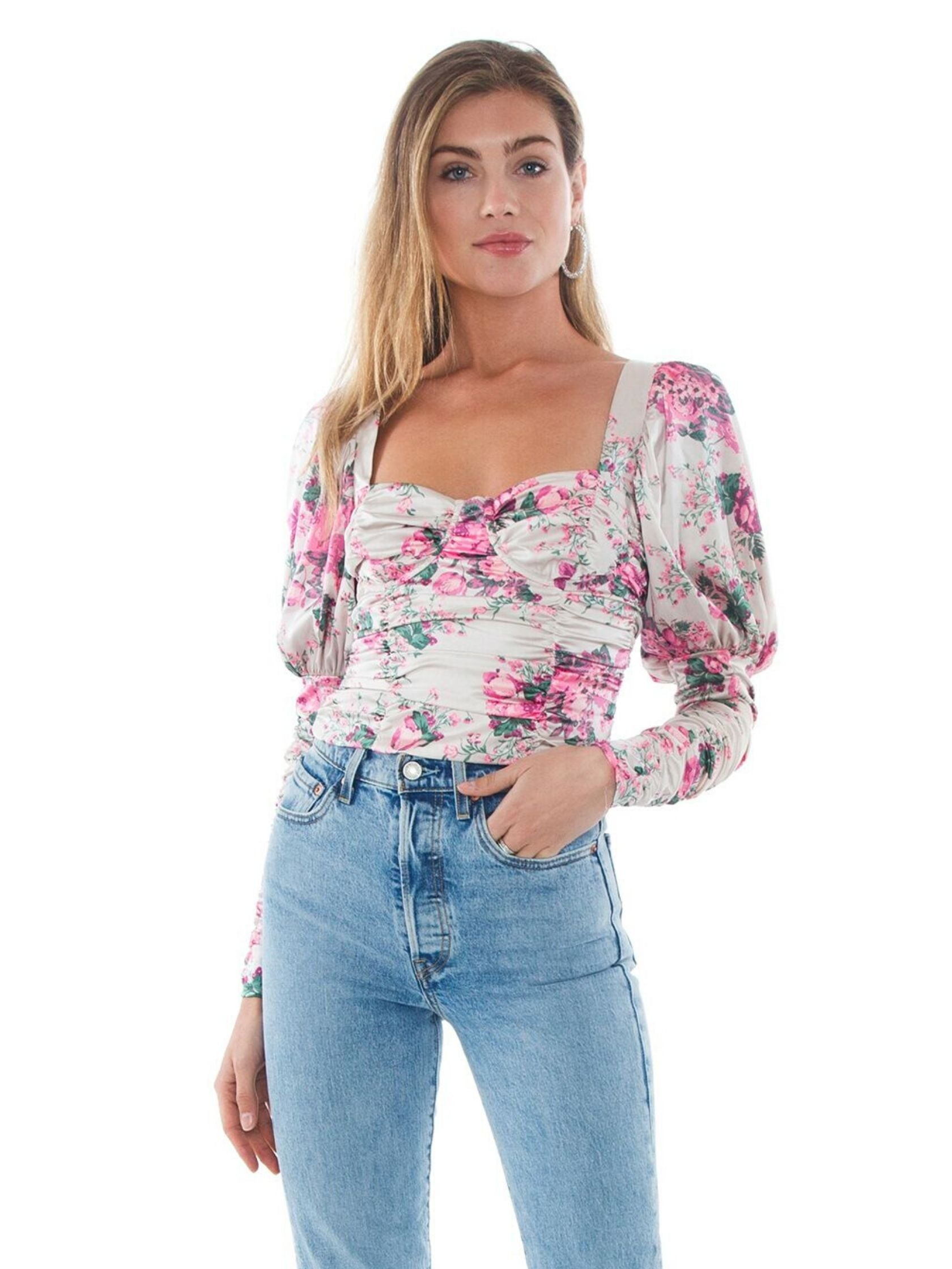 Woman wearing a top rental from For Love & Lemons called Palais Floral Crop Top