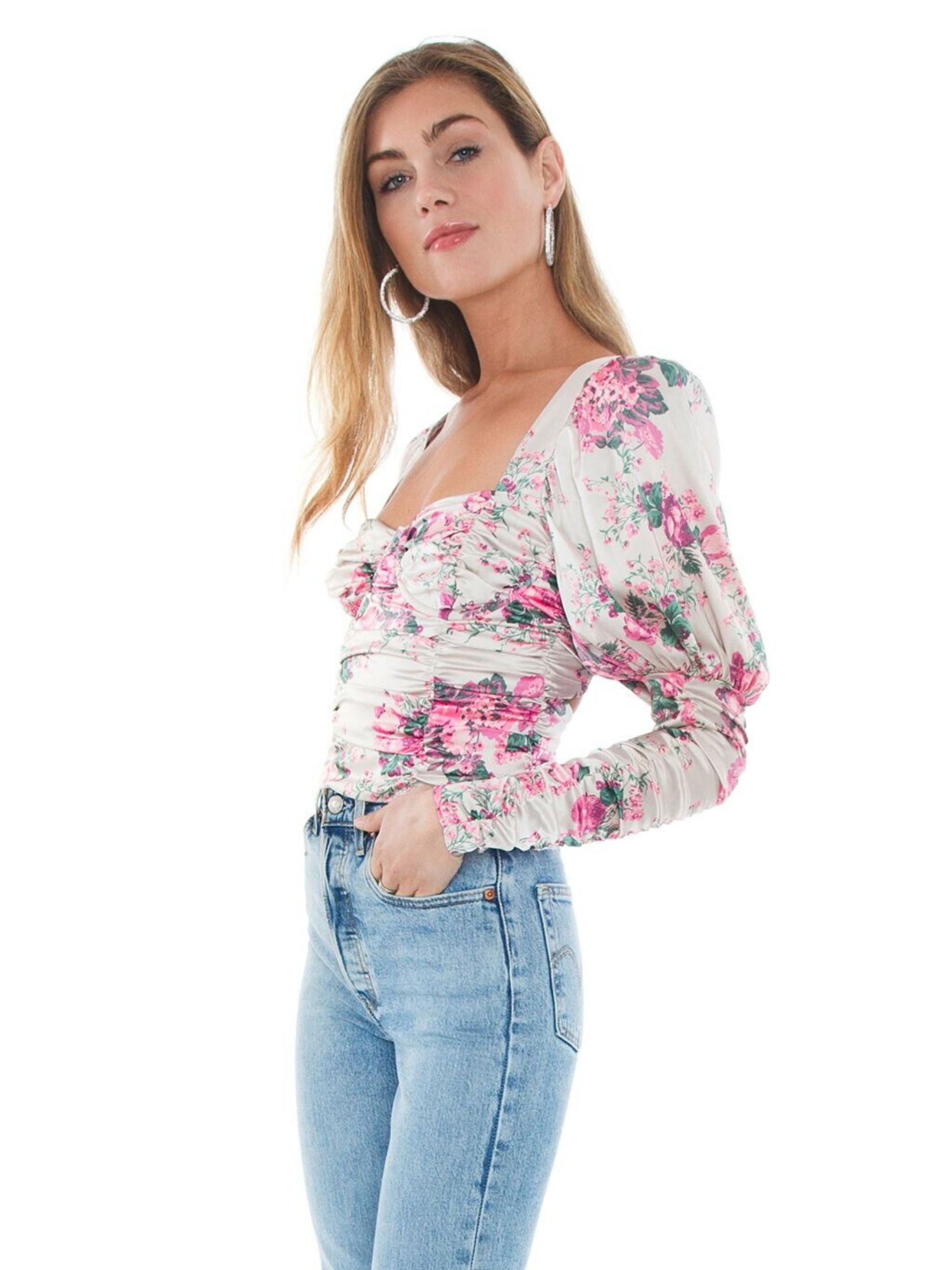 Women wearing a top rental from For Love & Lemons called Palais Floral Crop Top