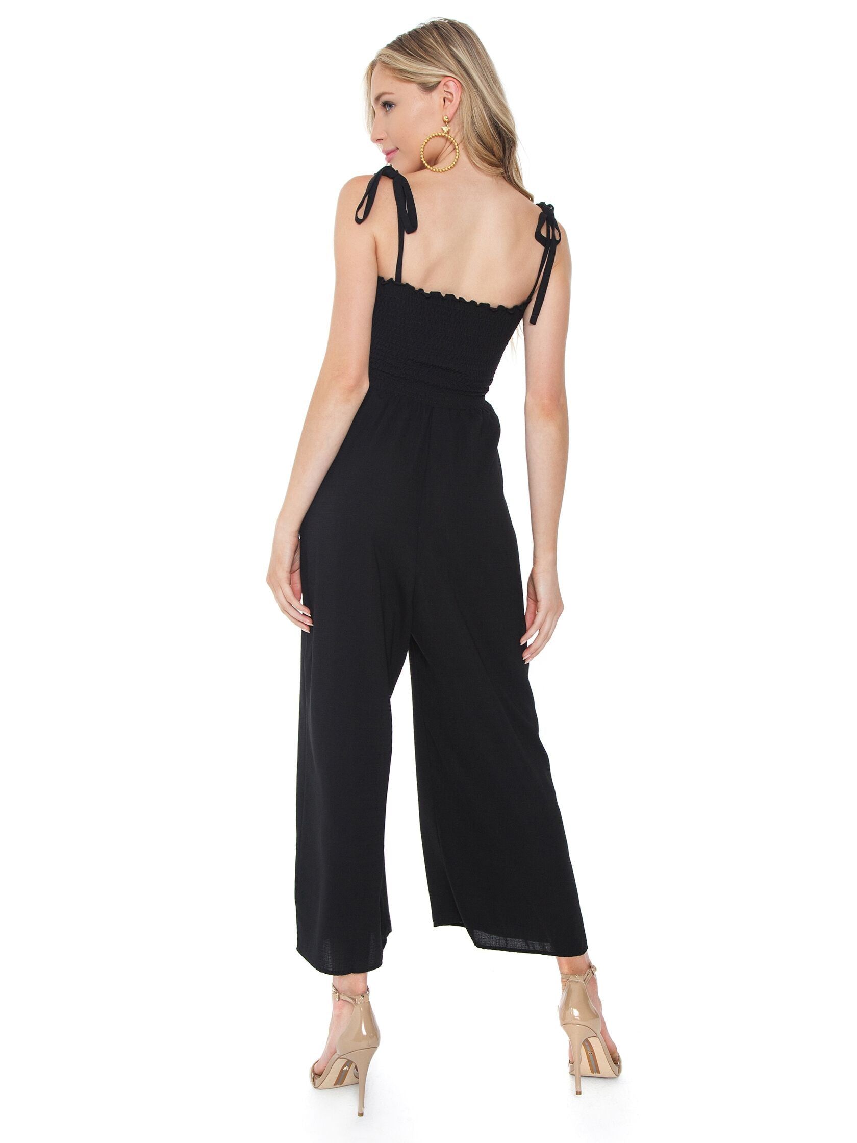 Women wearing a jumpsuit rental from Show Me Your Mumu called Parton Playsuit