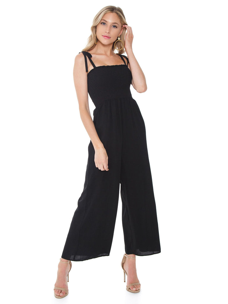 Woman wearing a jumpsuit rental from Show Me Your Mumu called Cropped Farah Trouser