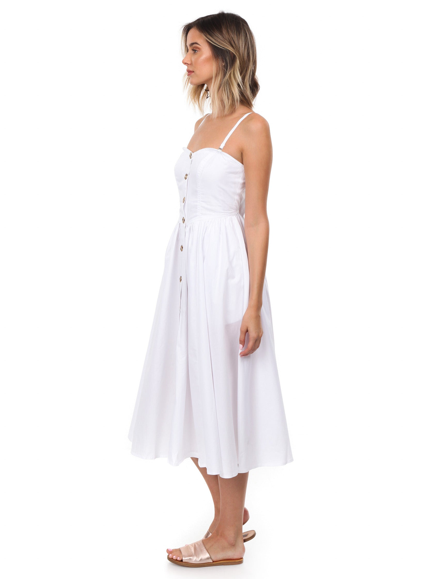 Woman wearing a dress rental from Free People called Perfect Peach Poplin Midi