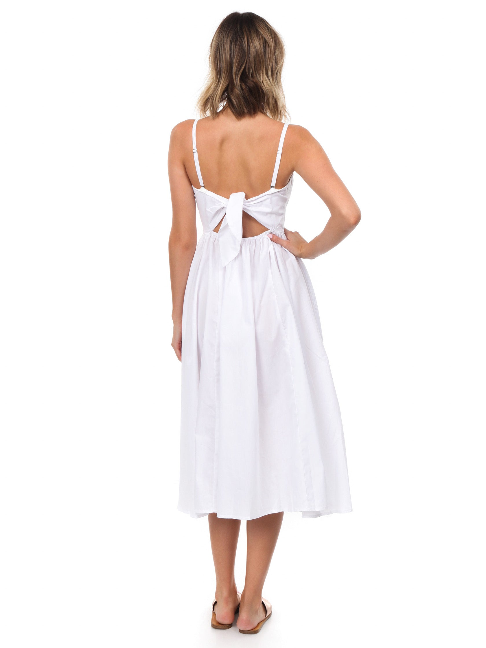 Women wearing a dress rental from Free People called Perfect Peach Poplin Midi