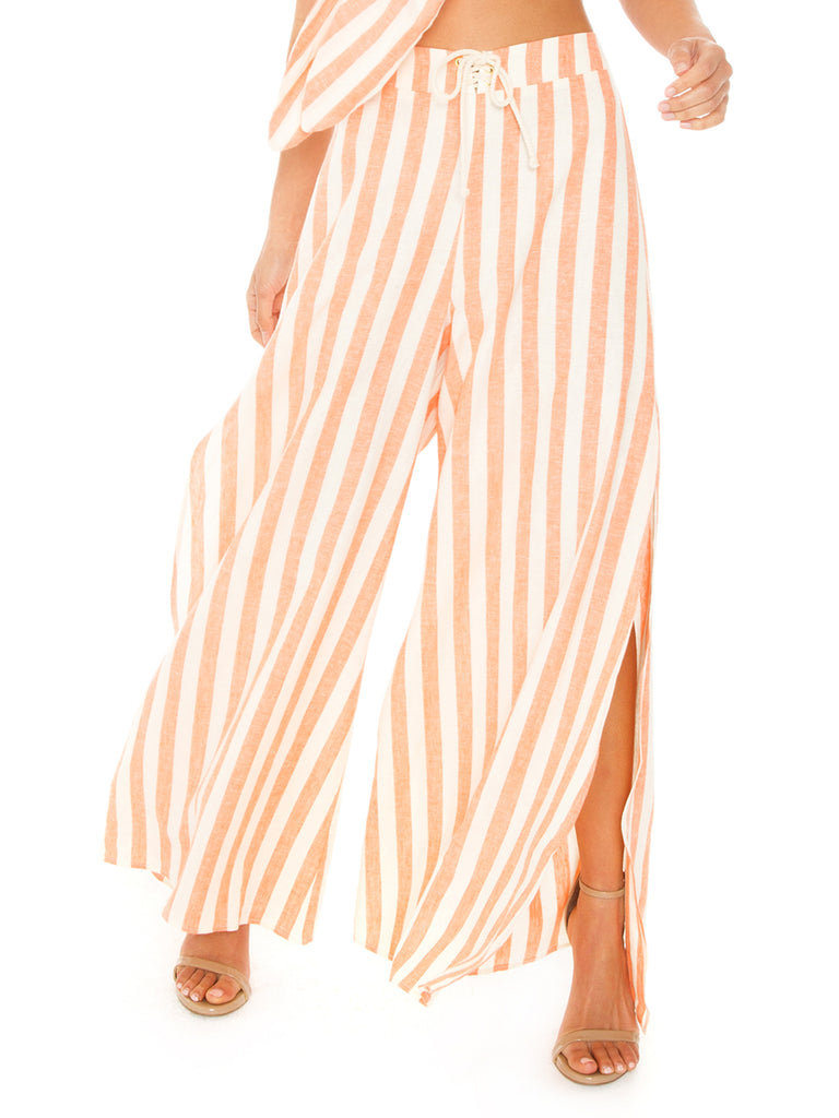 Women wearing a pants rental from Show Me Your Mumu called Mahi Drawstring Top