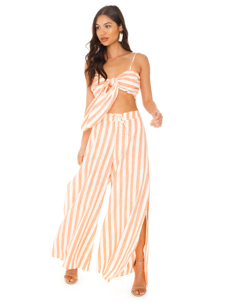 Girl outfit in a pants rental from Show Me Your Mumu called Riviera Romper