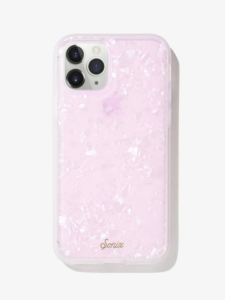 Women wearing a phone case rental from Sonix called Pink Pearl Tort Iphone 11 Pro/xs/x