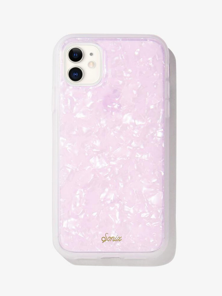 Women wearing a phone case rental from Sonix called Pink Pearl Tort Iphone 11/xr