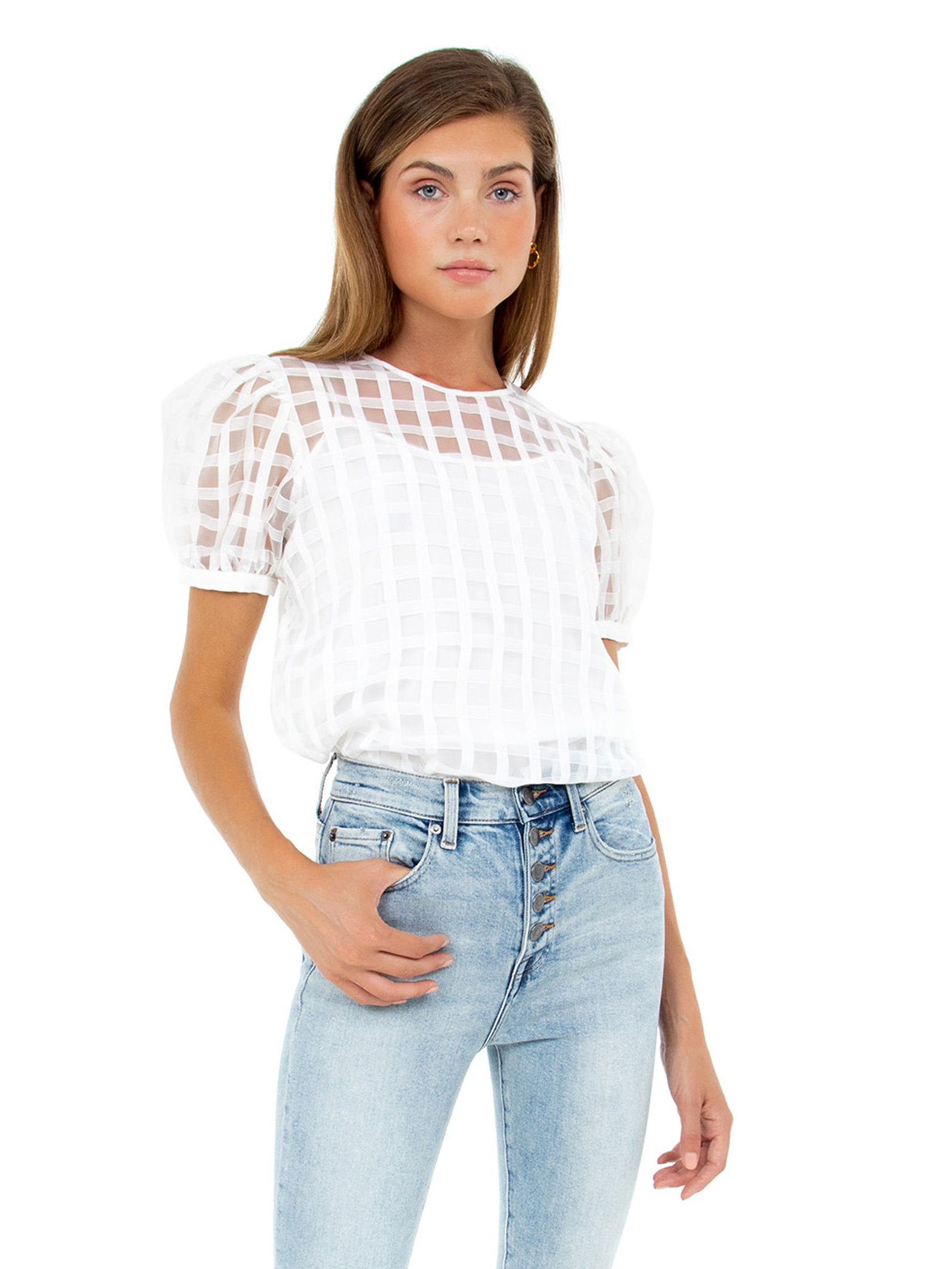 Woman wearing a top rental from English Factory called Plaid See Through Top