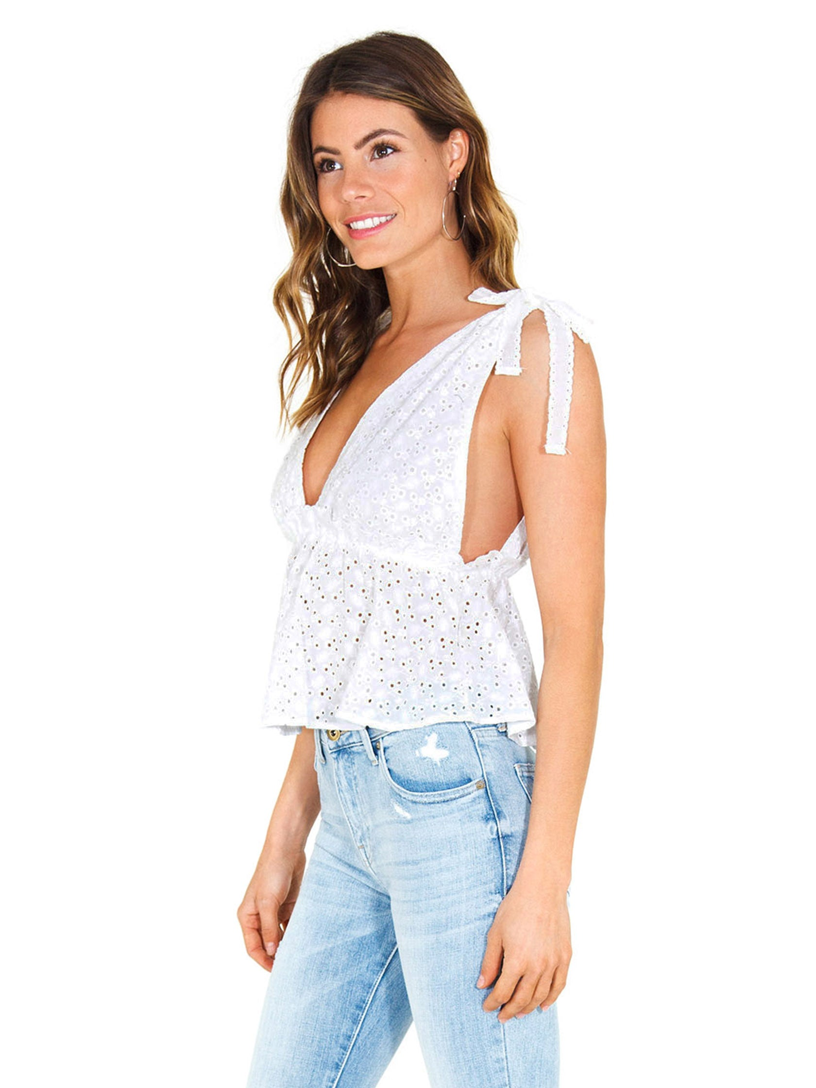 Women wearing a top rental from FashionPass called Plunging Eyelet Top