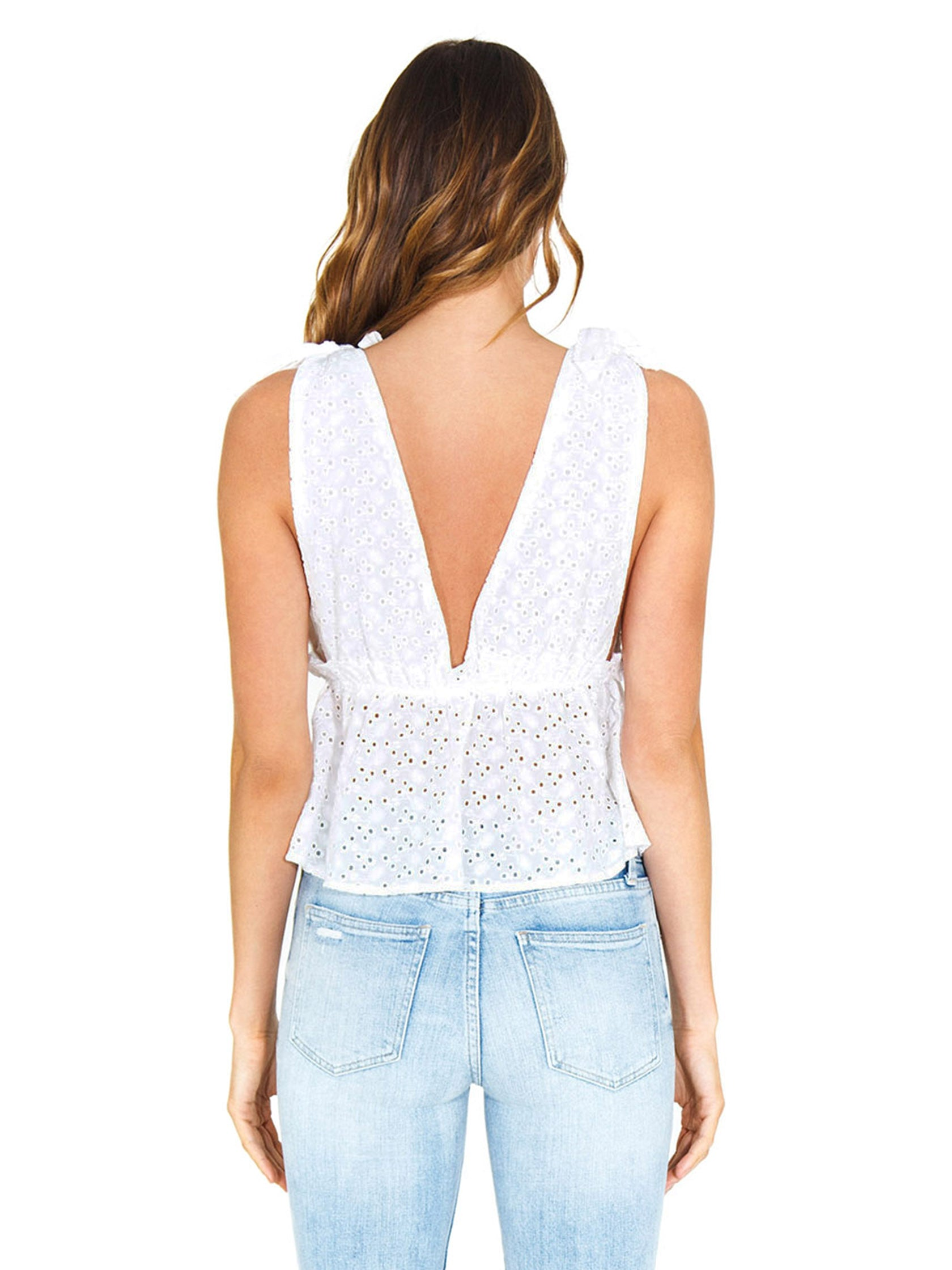 Women outfit in a top rental from FashionPass called Plunging Eyelet Top