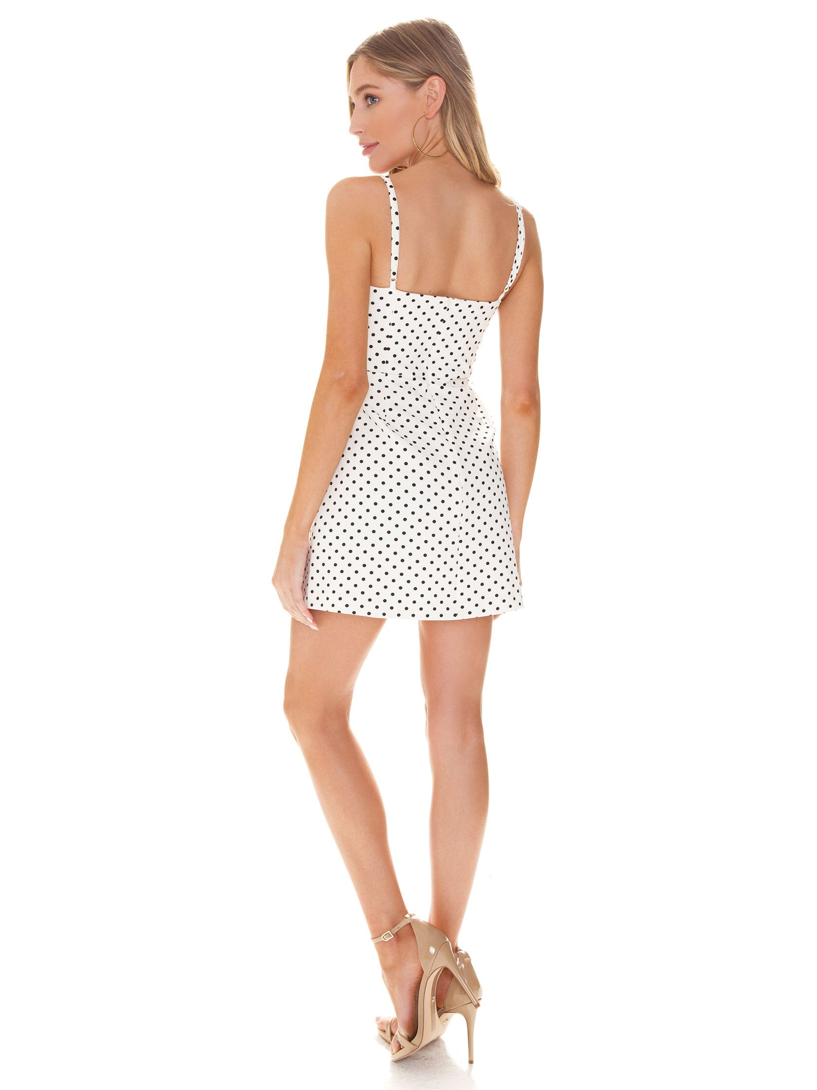 Women wearing a dress rental from French Connection called Polka Dot Whisper Dress