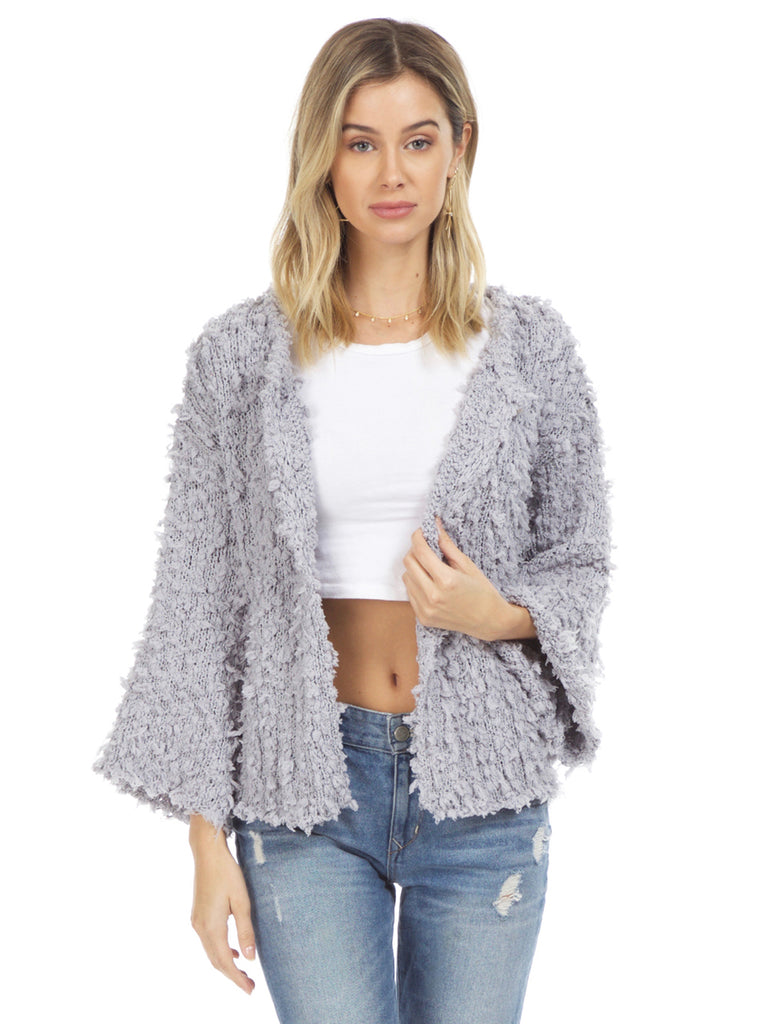 Women wearing a cardigan rental from Sadie & Sage called Popcorn Knit Cardigan