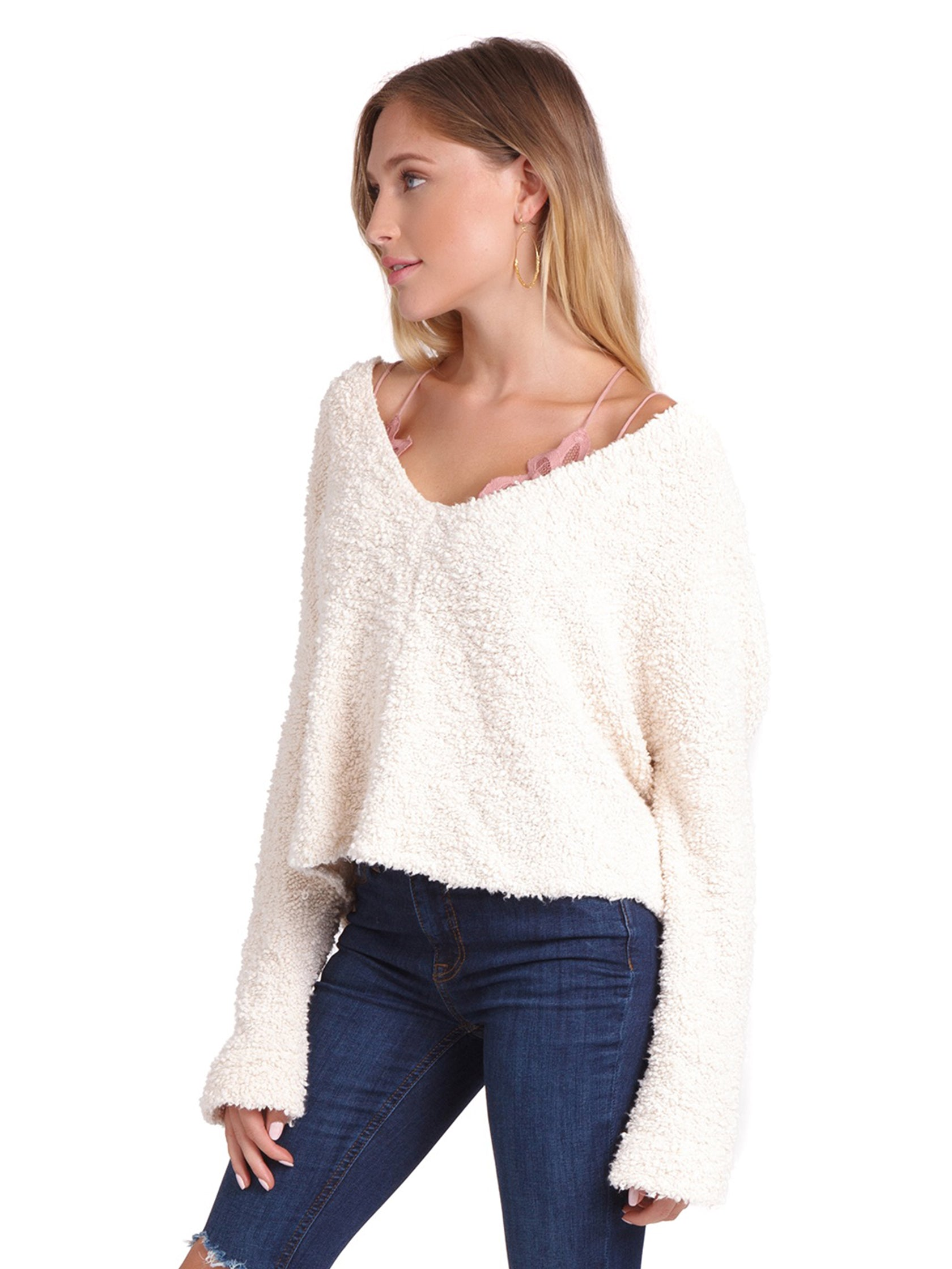 Women wearing a sweater rental from Free People called Popcorn Pullover