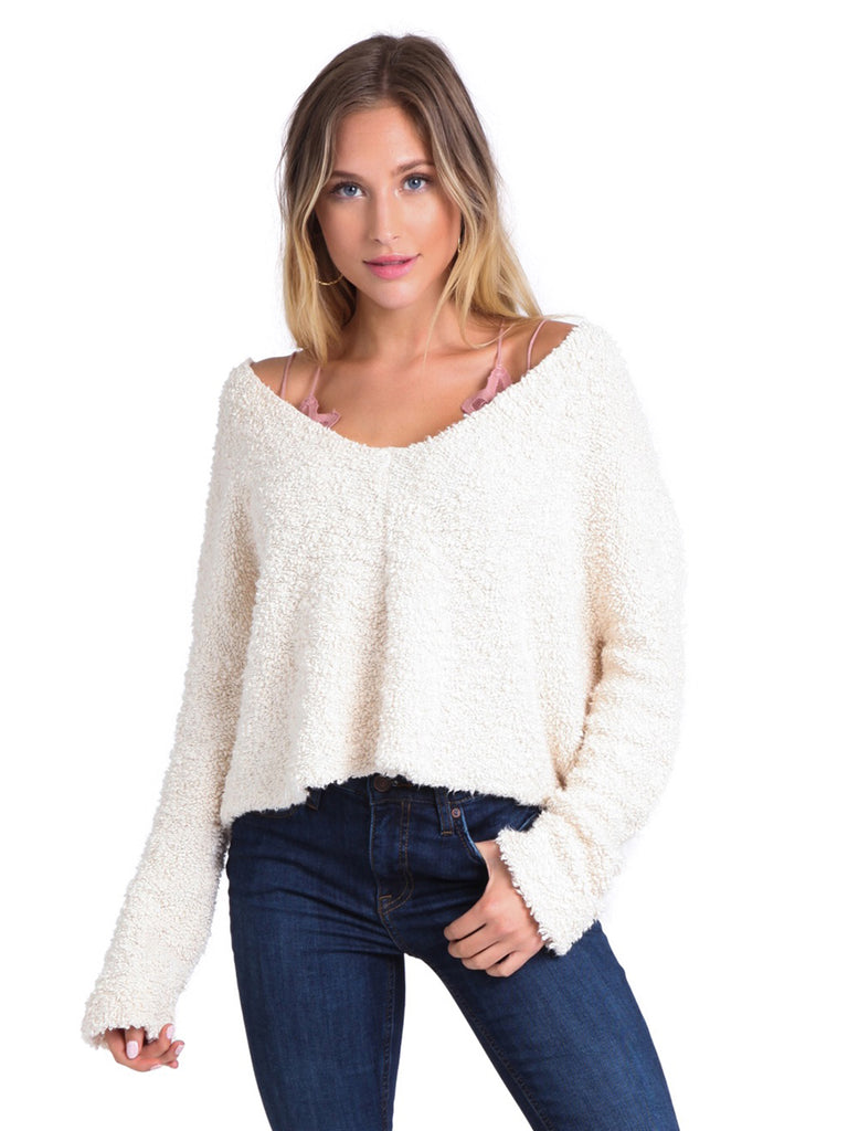 Woman wearing a sweater rental from Free People called Presley High Rise Girlfriend Jeans