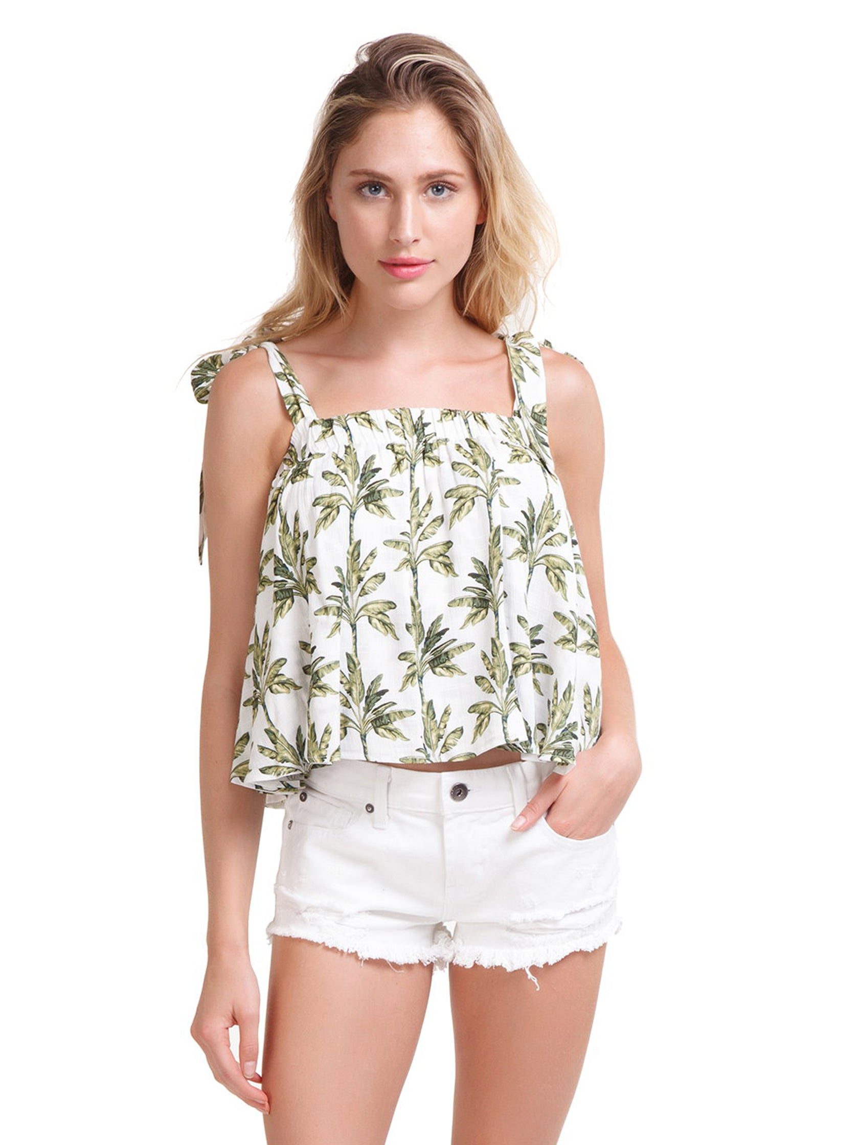 Woman wearing a top rental from Show Me Your Mumu called Poppy Swing Crop