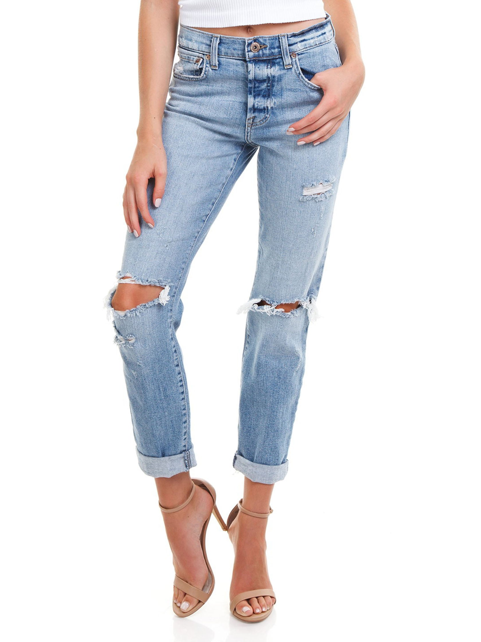 Woman wearing a denim rental from PISTOLA called Presley High Rise Girlfriend Jeans