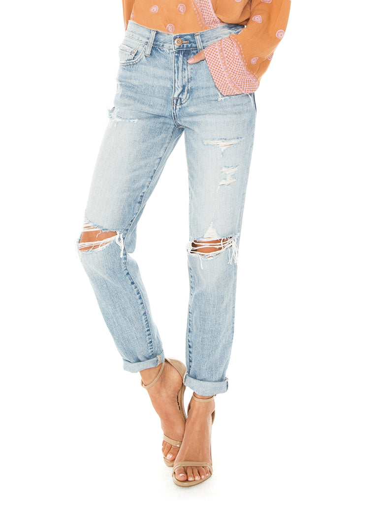 Women wearing a pants rental from PISTOLA called Presley High Rise Girlfriend Jeans
