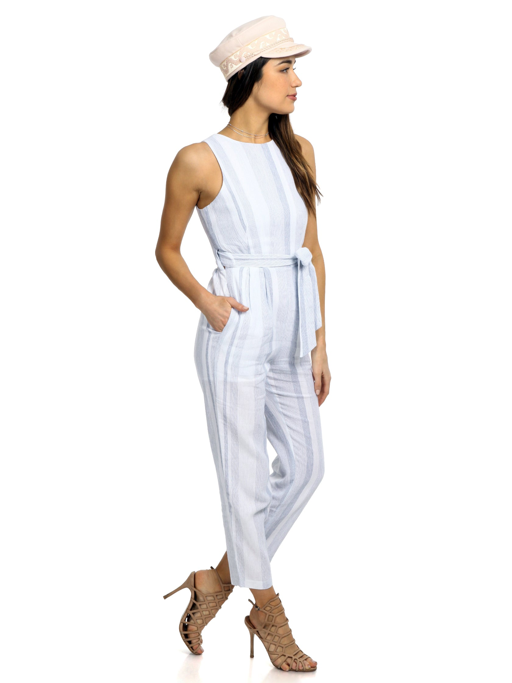 Woman wearing a jumpsuit rental from ASTR called Presley Jumpsuit