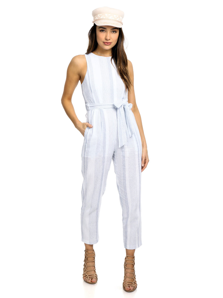 Woman wearing a jumpsuit rental from ASTR called Hayden Pants