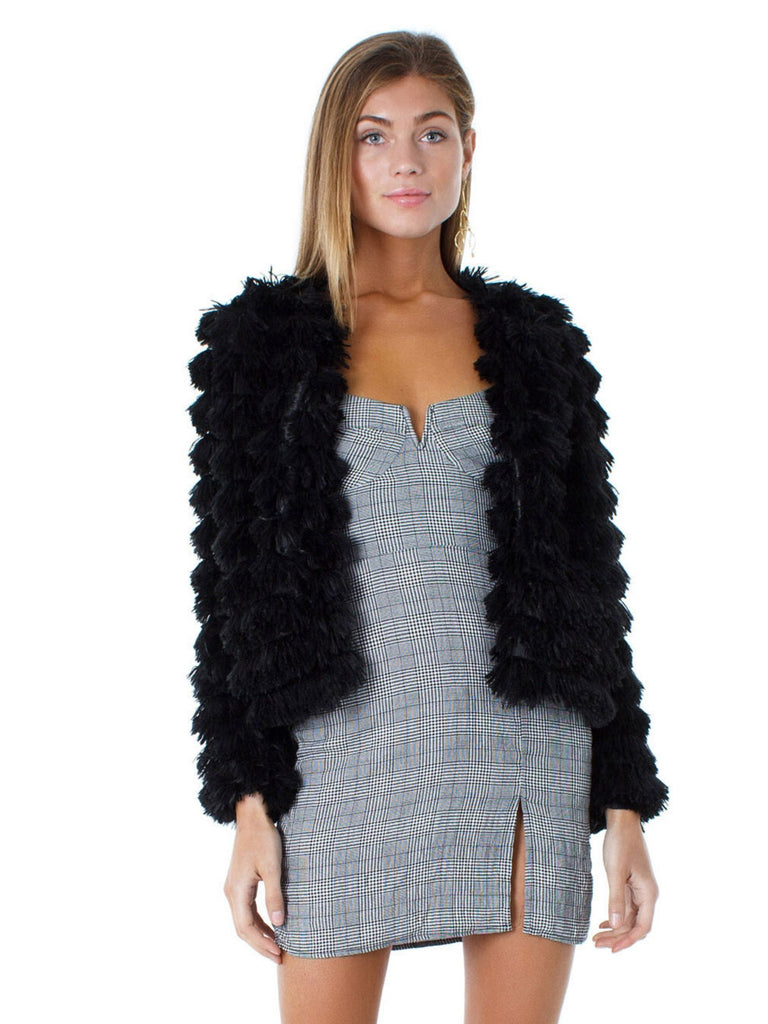 Women wearing a jacket rental from SAGE THE LABEL called Fab Moment Faux Fur Jacket