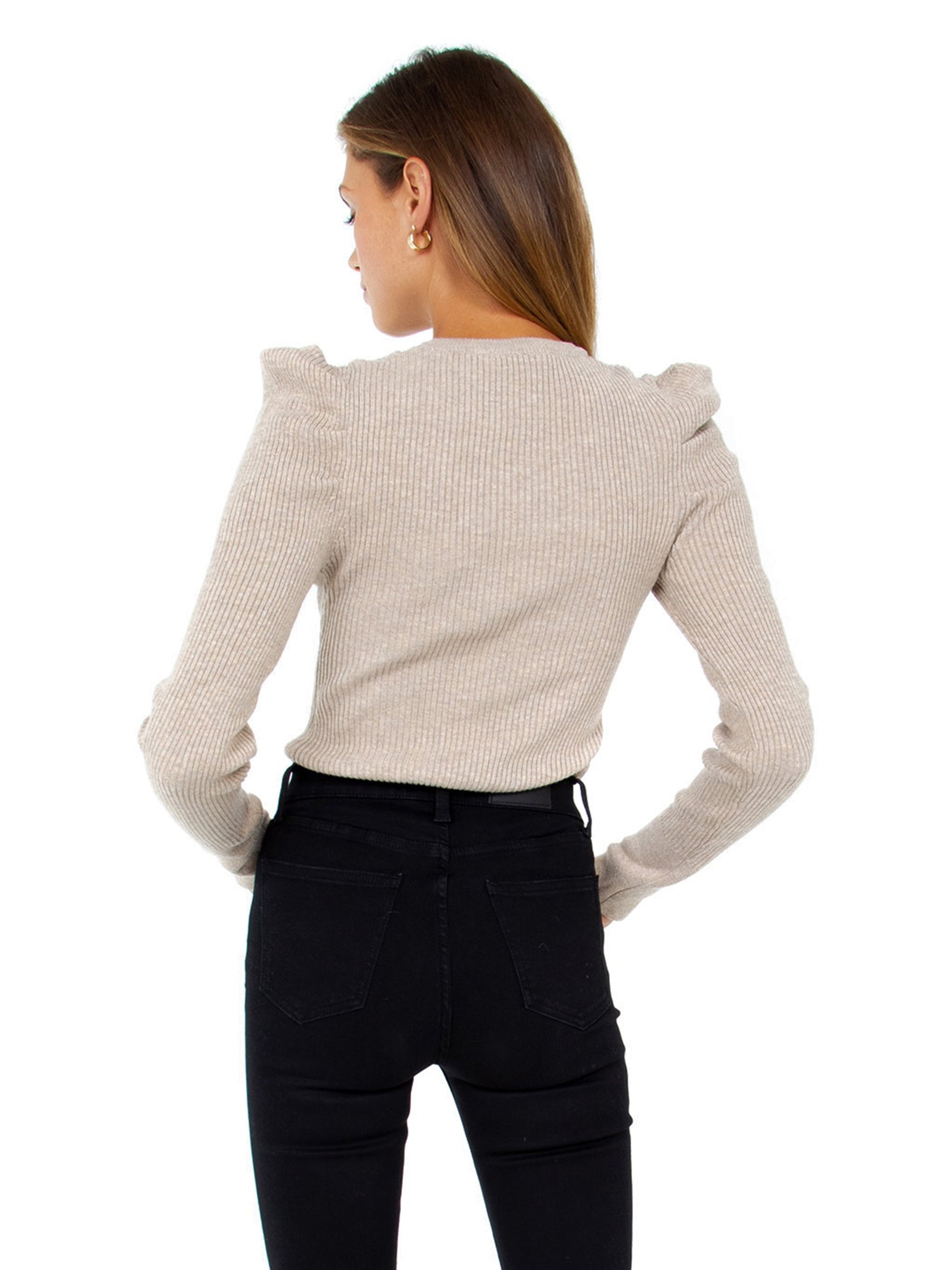 Women outfit in a sweater rental from FashionPass called Puff Sleeve Rib Sweater