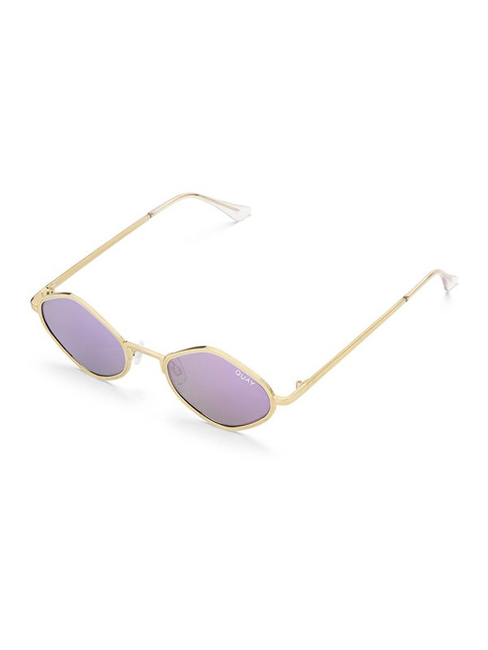Woman wearing a sunglasses rental from Quay Australia called Purple Honey Sunglasses