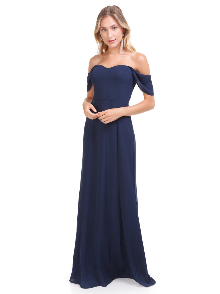 Girl wearing a dress rental from WAYF called Abby Off Shoulder Tiered Maxi Dress