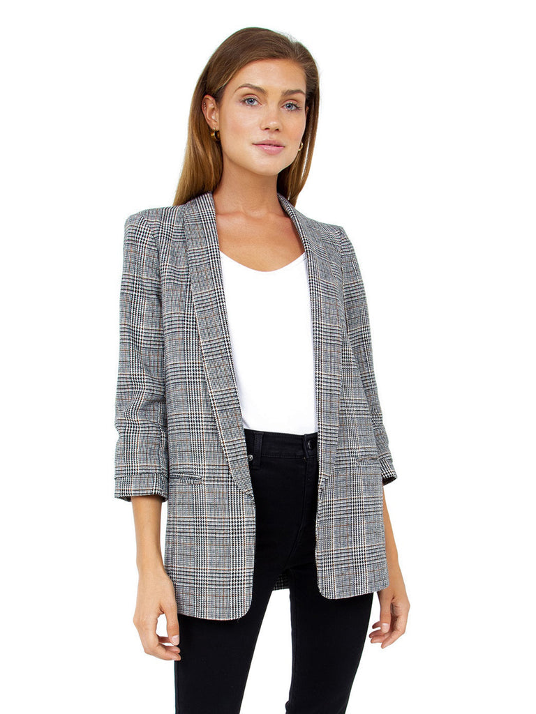 Woman wearing a blazer rental from BLANKNYC called Ribbed Bike Short