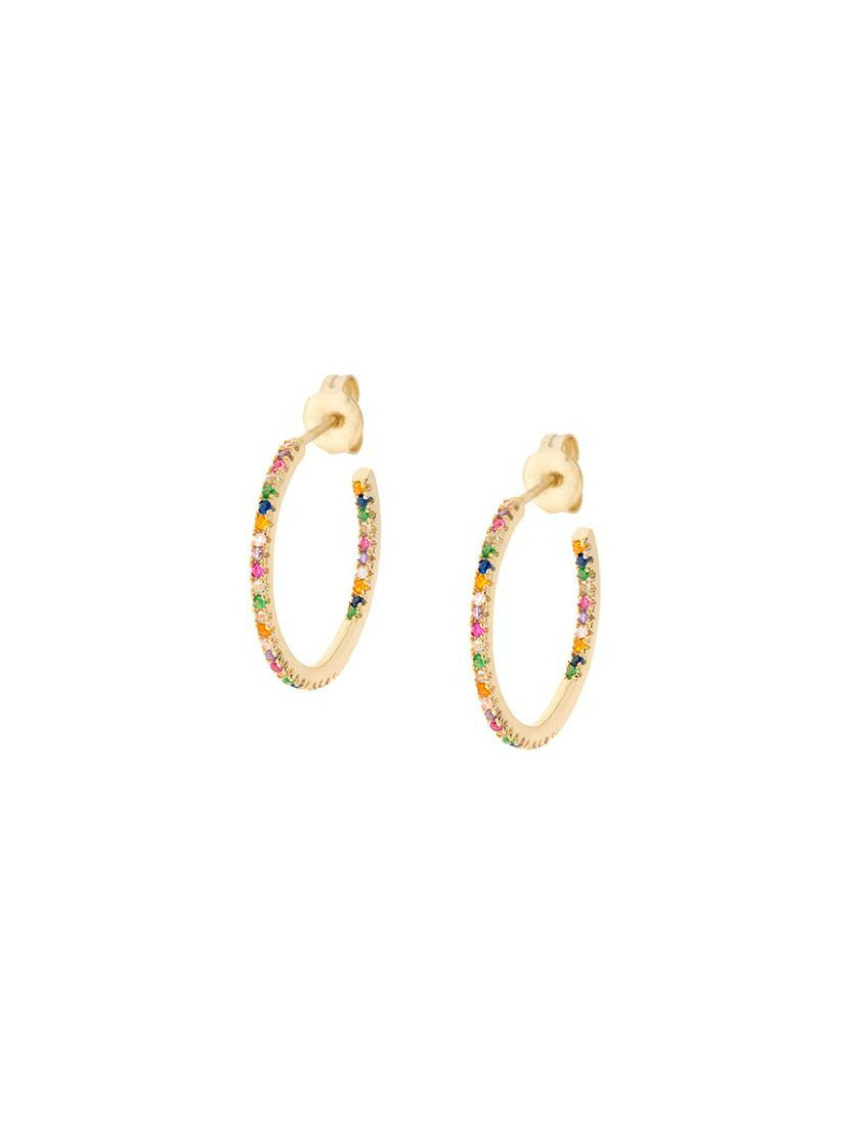 Woman wearing a earrings rental from Shashi called Rainbow Medium Hoop