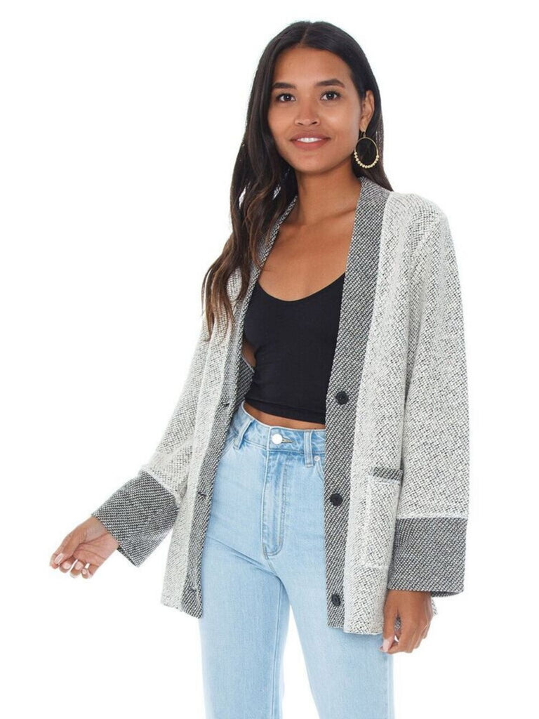 Woman wearing a cardigan rental from BB Dakota called Meowie Wowie Jacket