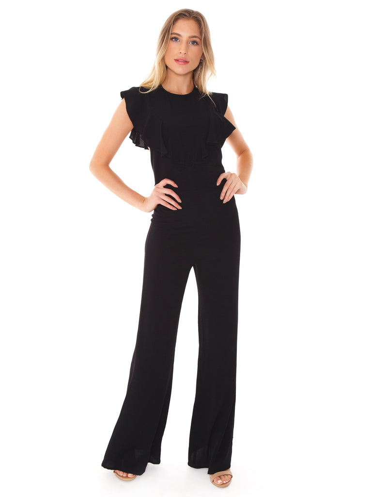 Woman wearing a jumpsuit rental from Flynn Skye called Brynn Deep Plunge Dress