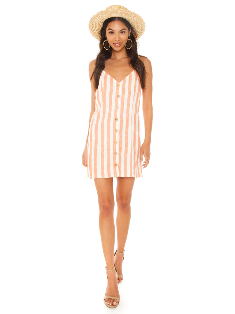 Girl outfit in a dress rental from Show Me Your Mumu called Riviera Romper
